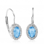Boucles d'oreilles topaze bleu et diamants sur anneau